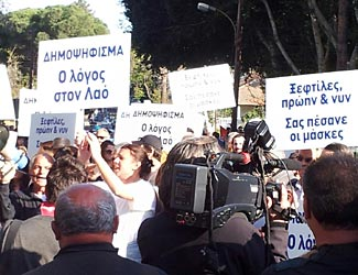 Cypriot citizens protesting the EU imposed raid on their bank savings.