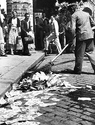As part of the world's worst ever hyper-inflation, banknotes were thrown away in the streets as being worthless - Hungary, 1946.