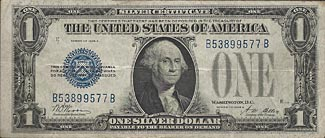 This silver dollar banknote was redeemable for a 'real' silver dollar.  The notes were withdrawn in 1964 and modern fiat banknotes can not be redeemed for anything at all.