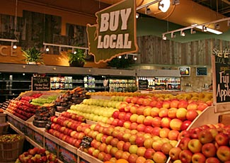 The sign says 'buy local' but even if these 'fresh' apples are local, they have probably still been sitting in a cool store for many months before being shipped to the supermarket.