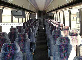 There is a small galley/kitchenette as well as restroom at the rear of this 1995 Prevost, 46 seats, about $25,000.